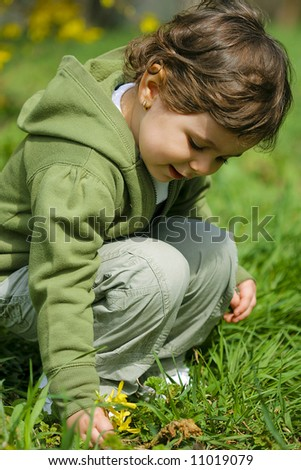 Beautiful baby girl playing in the park - stock photo