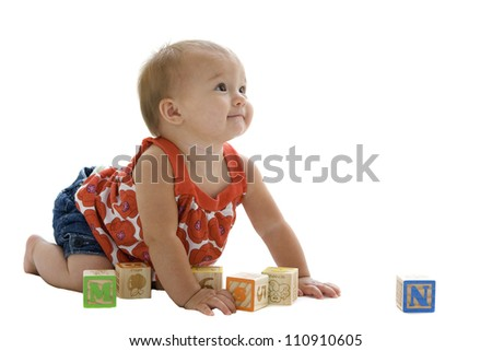 Beautiful baby girl playing with blocks - stock photo