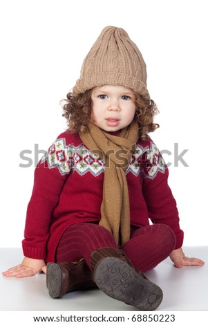 Beautiful baby girl with wool cap isolated over white background