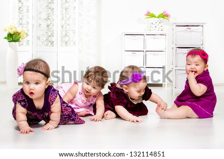Beautiful baby girls group in festive dresses - stock photo