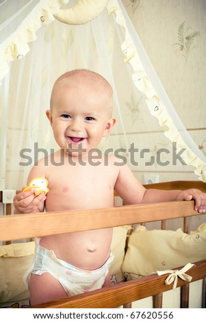 beautiful baby in bed - stock photo
