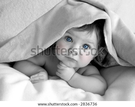 beautiful baby in black and white with blue eyes and pink cheeks - stock photo