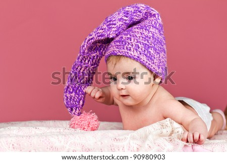 beautiful baby in knitted cap like a leprechaun - stock photo