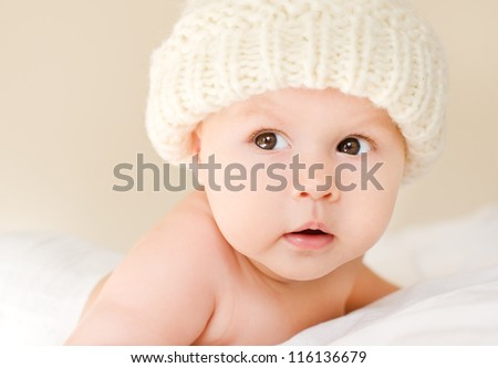 Beautiful baby in the white hat