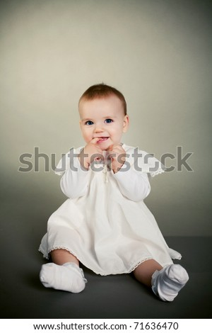 beautiful baby in white dress - stock photo