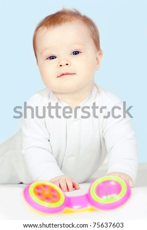 Beautiful baby is playing - stock photo