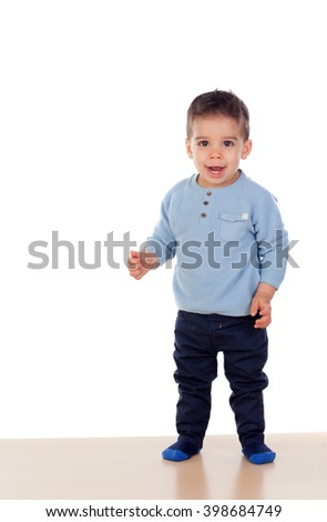 Beautiful baby learning to walk isolated on white background - stock photo