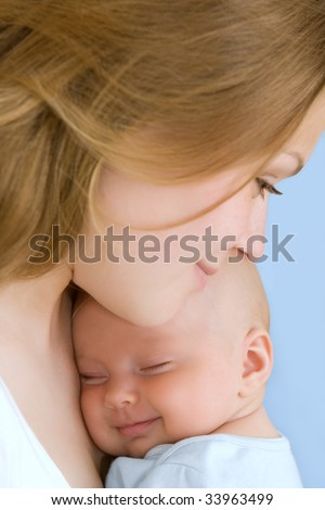 Beautiful baby of three months old in his mothers hands. - stock photo