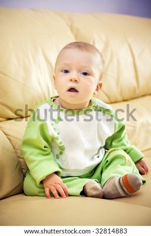 beautiful baby on sofa