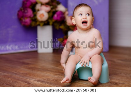 beautiful baby on the pot - stock photo