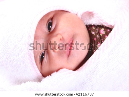 Beautiful baby on white blanket. Only face - stock photo