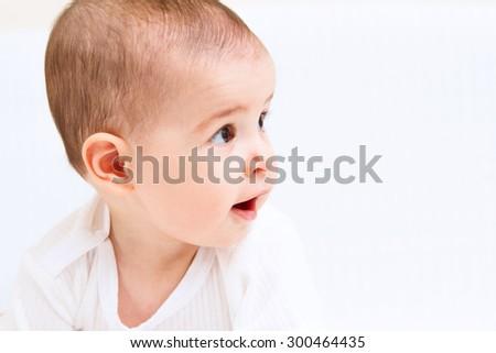 Beautiful baby portrait on white background - stock photo
