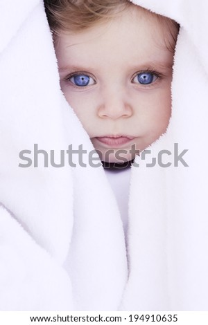 beautiful baby portrait with blanket - stock photo