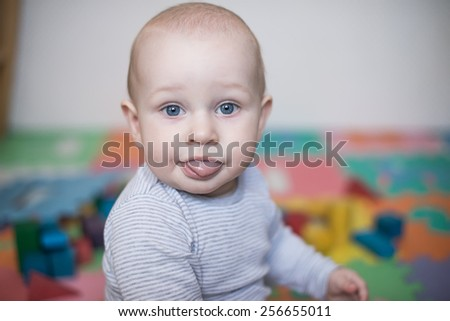 beautiful baby shows the language  in the nursery