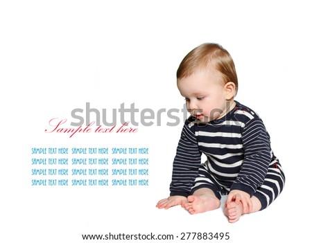 beautiful baby sits and looking down at sample text on white background - stock photo