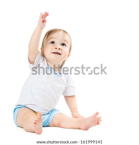 beautiful baby sitting and points his hand up - stock photo