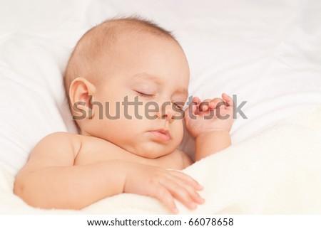 beautiful baby sleep on a white background - stock photo