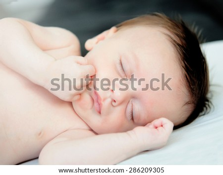 Beautiful baby sleeping the nap in the crib - stock photo