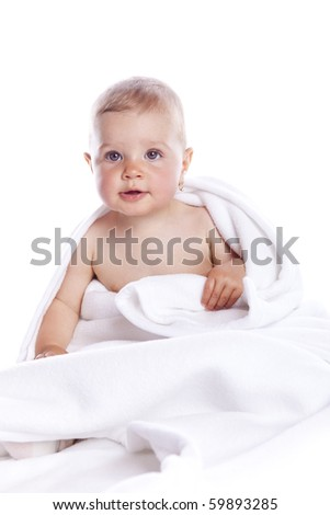 beautiful baby under a white towel on white background