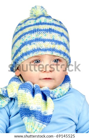 Beautiful baby warm with hat and scarf isolated on white background - stock photo