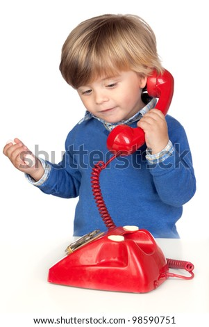Beautiful baby with a red phone isolated on white background - stock photo
