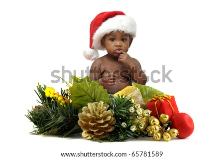 Beautiful baby with Christmas hat and decoration isolated in white