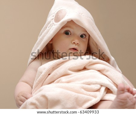 Beautiful baby wrapped in a pink blanket after bath - stock photo