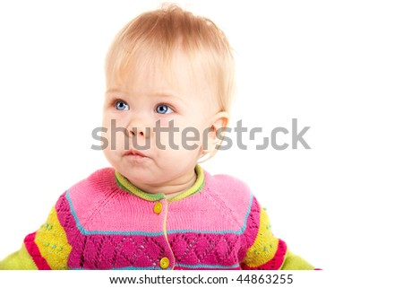 Beautiful babygirl in colorful jacket on white background