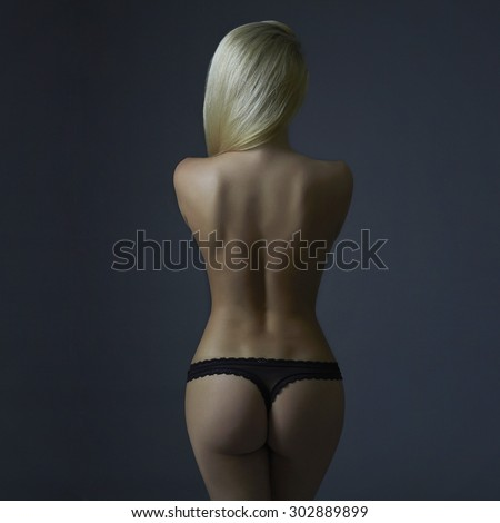 beautiful back of naked woman. nude girl. sexy young lady in underwear - stock photo