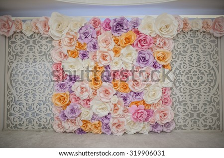 Beautiful backdrop flowers over white fabric decoration ready for wedding ceremony. - stock photo