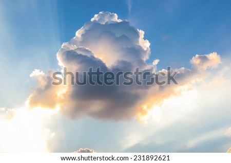 Beautiful background  bright sun shines through clouds - stock photo