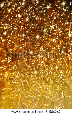 Beautiful background in gold with stars - stock photo