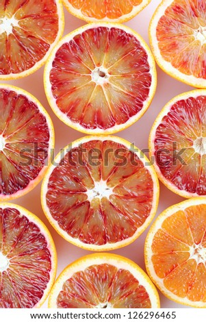 Beautiful background made of blood orange halves