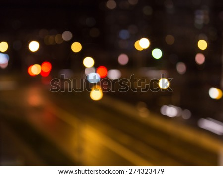 Beautiful background of bokeh lights at night on road with cars - stock photo