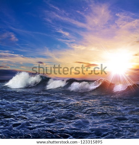 Beautiful background. Seaview with breaking waves pink clouds at the sunset time - stock photo