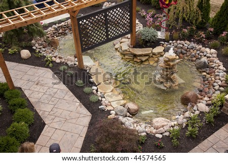 Beautiful backyard fountain and pool - stock photo