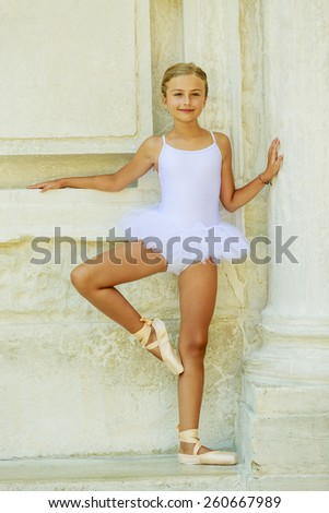 Beautiful ballet-dancer in white dress and pointe shoes dancing in Venice Italy - stock photo
