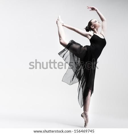 Beautiful ballet-dancer, modern style dancer posing on studio background - stock photo