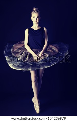 Beautiful ballet dancer posing at studio. - stock photo