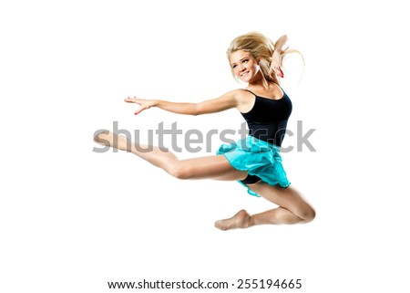 beautiful ballet dancer posing on a studio background
