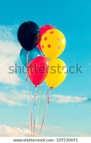 beautiful  balloons against sky with clouds, bright colors - stock photo