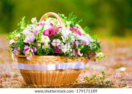 beautiful basket of flowers on a holiday in the garden - stock photo