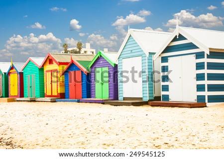 Beautiful Bathing houses on white sandy beach at Brighton in Melbourne, Australia. - stock photo