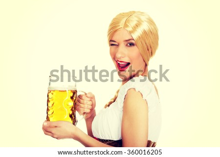 Beautiful bavarian woman with beer. - stock photo