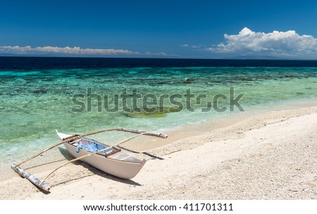 Beautiful beach against seaview with boat at Balicasag island, Philippines - stock photo