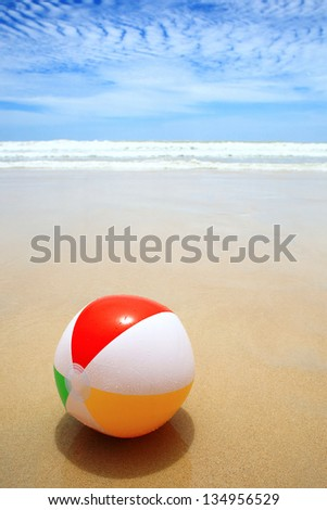 Beautiful beach and beach ball on the sand. - stock photo