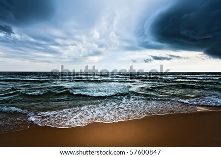 Beautiful beach and dramatic sky. Stormy weather - stock photo