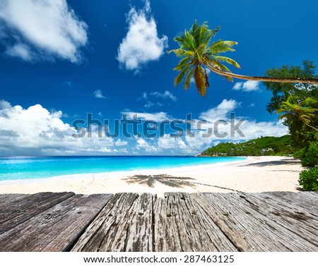Beautiful beach and old wooden pier at Seychelles, Mahe - stock photo