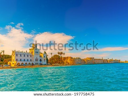 beautiful beach and the municipal building of Kos town at Kos island in Greece - stock photo