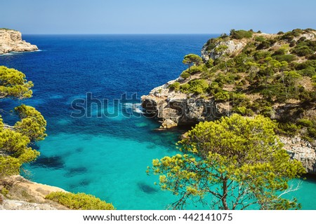 Beautiful beach bay azure sea water, Cala des Moro, Majorca island, Spain - stock photo